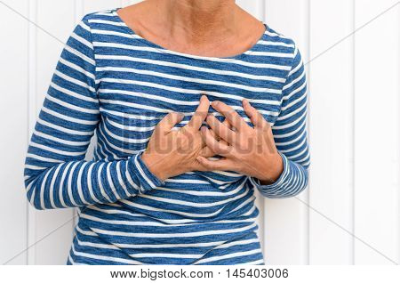 Woman Suffering Severe Chest Pains