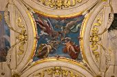 A colorful Italian Renaissance fresco on the arched ceiling of an ancient palace