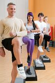 foto of step aerobics  - Group of healthy people with instructor doing aerobic exercises with step at gym - JPG