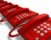 Row of red office phones