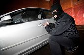 stock photo of hillbilly  - robber and the thief hijacks the car - JPG