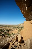 picture of dogon  - The Bandiagara site is an outstanding landscape of cliffs and sandy plateaux with some beautiful Dogon architecture - JPG