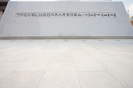foto of hangul  - The base of the King Sae Jong Dae statue contains the original Hangul alphabet that he is credited in creating - JPG