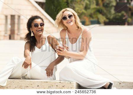 Two Multiracial Girlfriends Having Fun