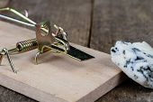 Mousetrap On An Old Wooden Table. Metal Accessories For Extermination Of Small Rodents. poster