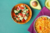 Traditional National Mexican Tomato Rice Stewed Pilaf With Hot Chili Peppers Garlic In Turquoise Bow poster