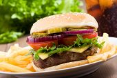 pic of hamburger  - hamburger with vegetables and fries on wooden table - JPG