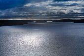 Small Stone Islands In Swedish Fiord Under Moonlight