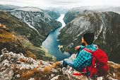 Man With Backpack Relaxing On Mountain Summit Traveling Alone In Norway Lifestyle Adventure Vacation poster