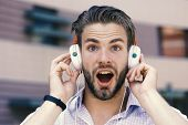 Man With Unshaven Face Enjoy Sound With Modern Headphones. Macho With Surprised Face Likes Music. Yo poster