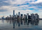 Panorama Of Manhattan In New York City With Artificial Water Showing Reflections poster
