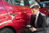 Insurance Agent Filling Insurance Form Near Damaged Red Car poster