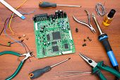 Electronic System Board With Microcircuits And Electronic Components. Necessary Tools For Repair. So poster