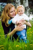 stock photo of defloration  - Young mother with little baby at the park - JPG