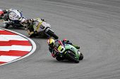 SEPANG, MALAYSIA - OCTOBER 22: Moto2 rider Dominique Aegerter (77) competes with other riders at the
