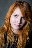 Disillusioned Smile - Moody Portrait Of Beautiful Young Redhead Girl.