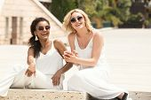 Two Multiracial Girlfriends Having Fun Together. poster