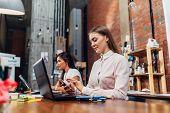 Friendly Female Office Workers Wearing Formal Workwear Typing On Laptop Keyboard Working In Creative poster