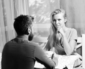 Couple In Love Holds Cups Of Coffee At Table. Woman And Flirty Face And Man Have An Affair. Girl Wit poster