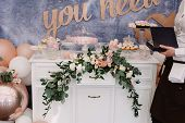 Beautiful Sweets On A Dresser. Stylish Candy Bar At A Modern Wedding. Candies, Pastries, Cakes Stand poster