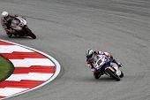 SEPANG, MALAYSIA - OCTOBER 22: 125cc rider Maverick Vinales (25) competes at the qualifying session of the Shell Advance Malaysian Motorcycle Grand Prix 2011 on October 22, 2011 at Sepang, Malaysia.