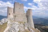 stock photo of apennines  - ruins of ancient fortification in barren landscape of apennine high mountains - JPG