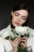 Portrait Of A Beautiful Girl With Peonies. Beauty Retouching Photo. Fashion And Cosmetic Concept. Gr poster
