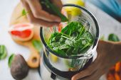 Man Cooking Healthy Detox Smoothie With Fresh Fruits And Green Spinach. Lifestyle Detox Concept poster