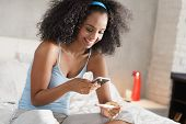 Happy Young Latino Woman Taking Photo Of Pregnancy Test Kit With Mobile Phone And Posting Picture On poster