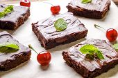 Moist Brownie Cake With Rich Dark Chocolate Taste Cut And Served In Square Slices. poster