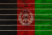National Flag  Of Afghanistan On A Wooden Wall Background. The Concept Of National Pride And A Symbo poster