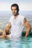 image of wet t-shirt  - Sexy young man in wet t - JPG