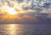 Natural Beautiful Tropical Sundown On The Sea With Dramatic Clouds. Sunset Sky Backlit By The Sun Ov poster