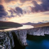 Incredible view of Sorvagsvatn lake on cliffs of Vagar island in sunset time, Faroe Islands, Denmark poster