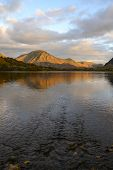 The Sun Is Setting On Grasmoor Fell Viewd From Loweswater In The Lake District,cumbria,uk. poster
