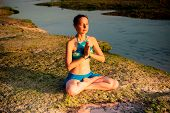 Young Woman Meditating, Practicing Yoga And Pranayama At The Beach. Sunset Yoga Practice. Hands In N poster