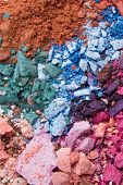 stock photo of blue eyes  - set of crushed eyeshadows as a background - JPG