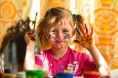 picture of fanny  - Little fanny girl drawing paint with paint of face - JPG