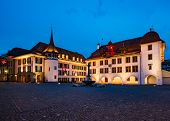 Picturesque Nightscape Of Illuminated Buildings And Town Hall Of Thun, Switzerland poster