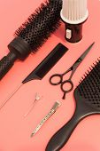 Flat Lay Composition With Hairdresser Set On Pink Background. Barber Set With Tools And Equipment: S poster