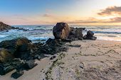 Sea Beach At Sunrise. Calm Waves Wash Huge Rocks. Golden Clouds On The Sky. Stunning Marine Scenery  poster