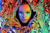 Color High Fashion Woman Neon Lights. Rainbow Make-up, Portrait Of A Girl Isolated On A Colored Back poster