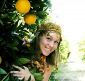 Pretty Islam Woman In Orange Grove Smiling, Real Muslim Girl Cheerful Close Up poster