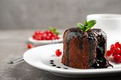 Delicious Warm Chocolate Lava Cake With Mint And Berries On Marble Table, Closeup. Space For Text poster