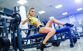 Blonde Sexy Fitness Woman In Sport Wear With Perfect Body In The Gym Posing Before Training Set. Att poster
