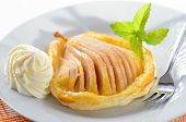 stock photo of phyllo dough  - Pear with honey on puff pastry - JPG