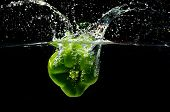 Sweet green pepper, splashing in water