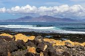 Panoramic View At The Coastline Of Corralejo On Canary Island Fuerteventura, Spain With  Lava Rocks  poster