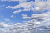 Blue Summer Sky With Bright White Cumulus Clouds. Fantastic Soft White Clouds Against Blue Sky. poster