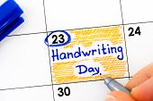 Woman Fingers With Pen Writing Reminder Handwriting Day In Calendar. January 23. poster